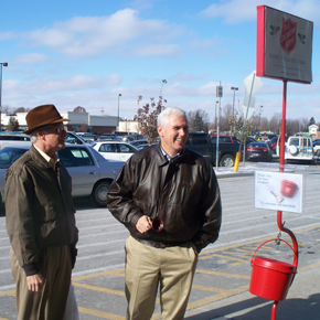 Congressman Mike Pence rings a bell at Walmart in Anderson.