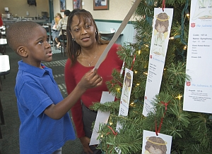A child helps his mother choose an Angel for their family to adopt.
