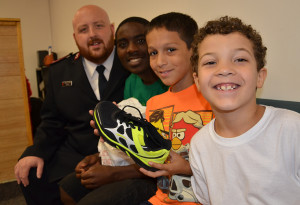 Khari helps summer day campers pick out new shoes at a back-to-school event