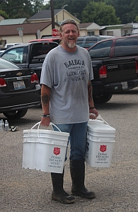 Pastor Scott Kollman from New Life Church delivering Flood Kits