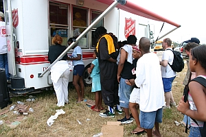 Survivors are served food and water from a Salvation Army canteen