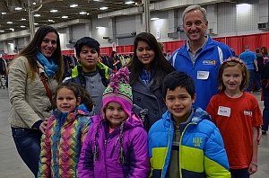 WTHR's John Stehr helps a family find coats, hats & gloves at Coats for Kids