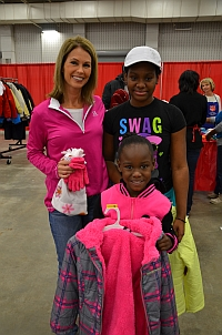 Angela Buchanan helps sisters Daejanay & Mauriana shop for coats