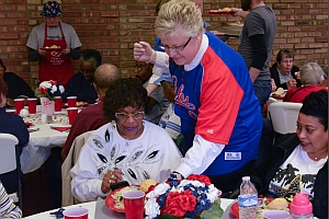 Major Beth Petrie helps to serve lunch at The Salvation Army Eagle Creek Corps